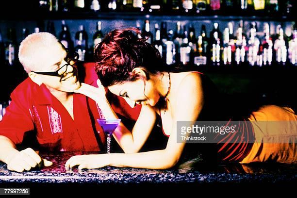 couple in bar - thinkstock foto e immagini stock