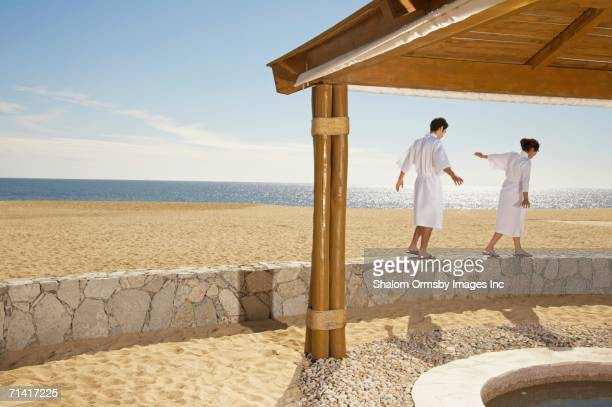 Couple in bathrobes at beach