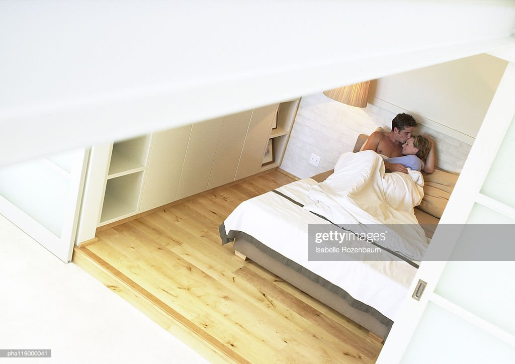 Couple in bed, embracing, high angle view : Stockfoto