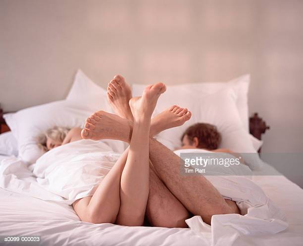 Couple in Bed Feet Entwined