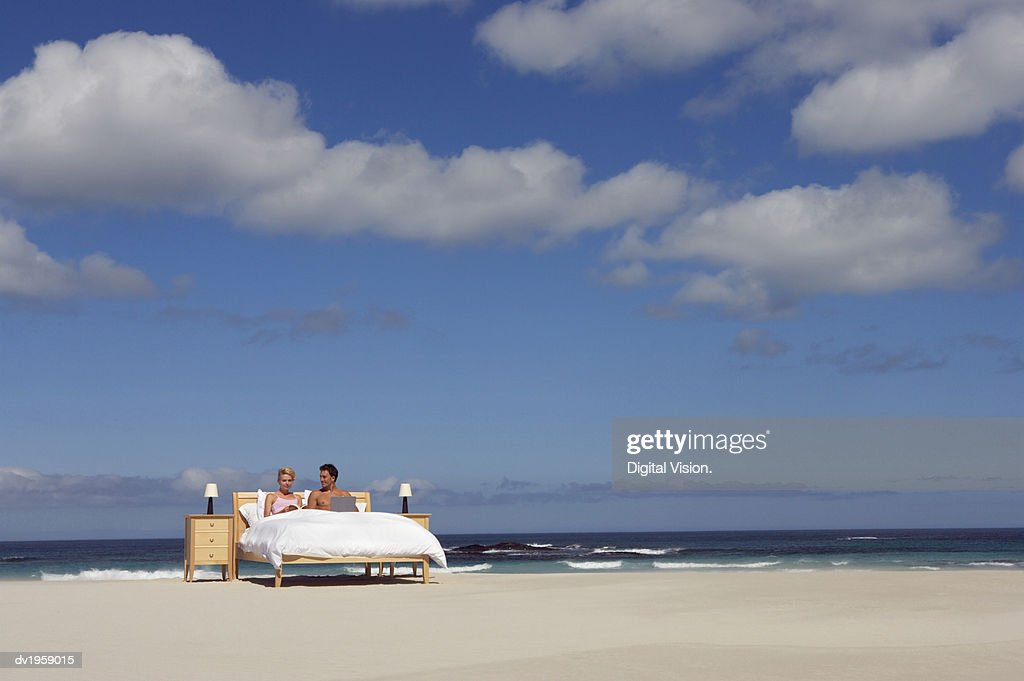 Couple in Bed on the Beach : Stock Photo