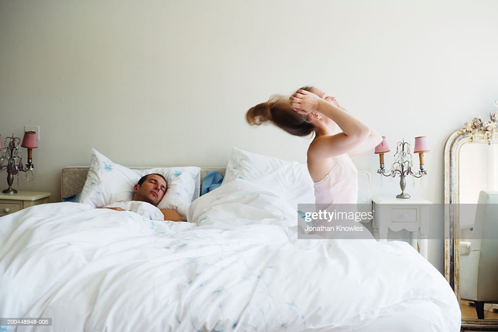 Bedroom side view King Size Bed Couple In Bed Side View Of Woman Throwing Head Back Man Asleep Stock Getty Images Couple In Bed Side View Of Woman Throwing Head Back Man Asleep Stock