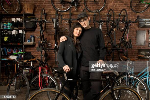 Couple in bicycle shop