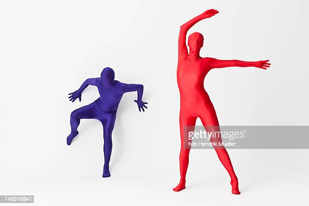 couple in bodysuits dancing - bodysuit stock pictures, royalty-free photos & images