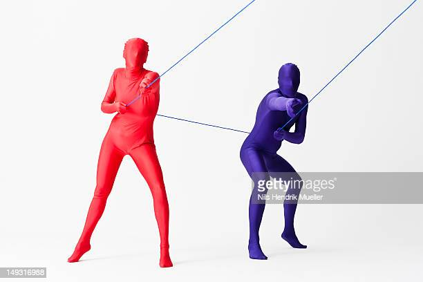 couple in bodysuits playing with string - bodysuit stock pictures, royalty-free photos & images