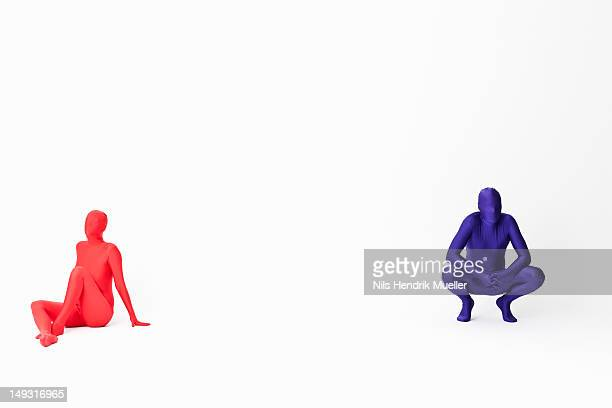 couple in bodysuits sitting on floor - bodysuit stock pictures, royalty-free photos & images