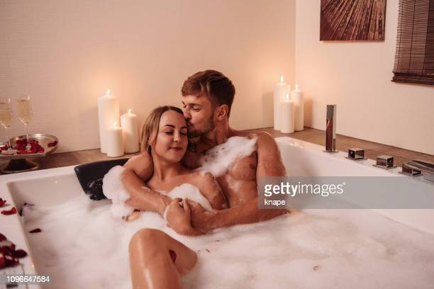 couple in bubble bath with champagne - couple bathtub stock pictures, royalty-free photos & images