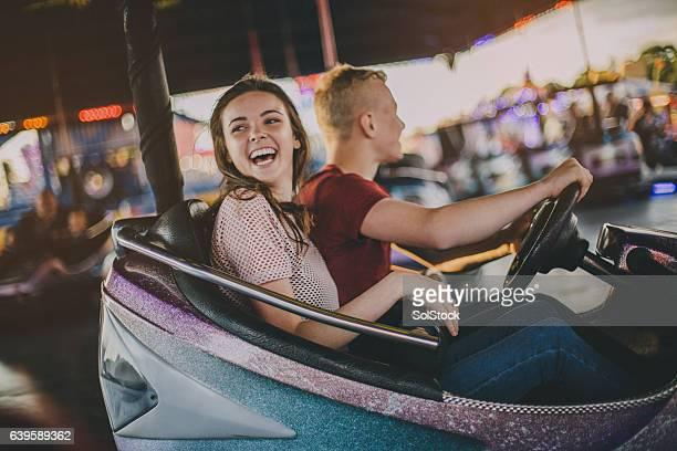 couple in bumper cars - volksfest stock-fotos und bilder