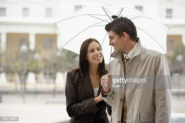 Couple in Business Suits with Umbrella