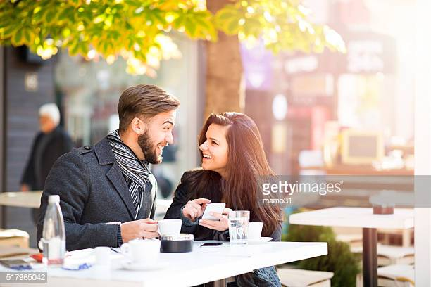 Couple in Cafe talking and shopping online