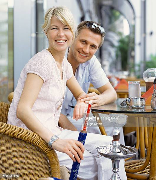 couple in cafe with water-pipe - hugh sitton stock pictures, royalty-free photos & images