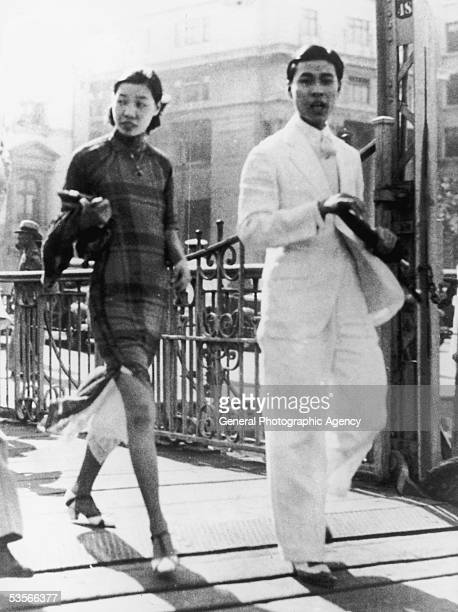 Couple in Canton wearing the latest western style fashions, 5th September 1935. Police have raided dressmakers and removed offenders from the street...