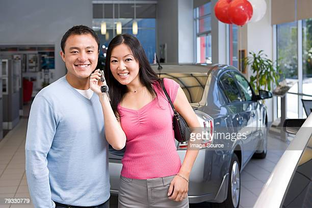 Couple in car showroom
