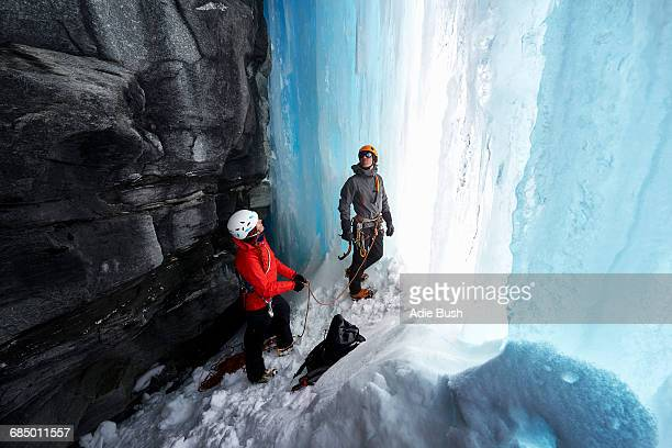 Couple in cave ice climbing, Saas Fee, Switzerland