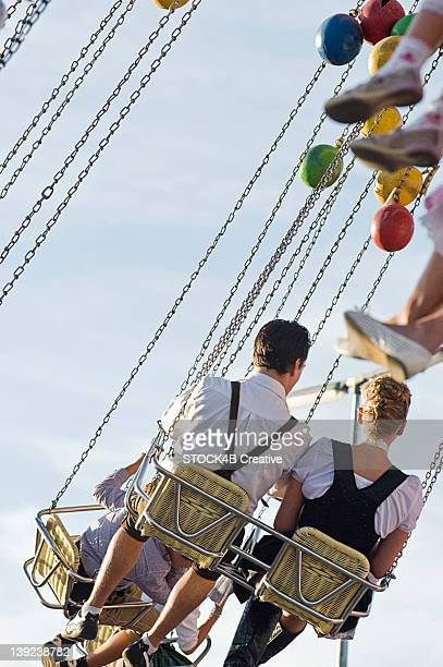 Couple in chairoplane on the Oktoberfest in Munich, Bavaria, Germany