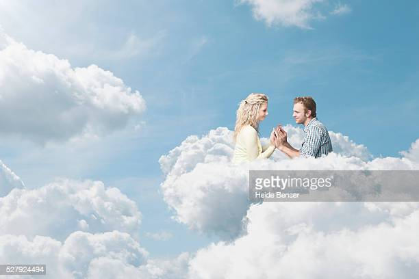 couple in clouds, digital composite - paradise stock pictures, royalty-free photos & images