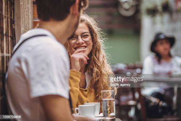 couple in coffee shop - city life stock pictures, royalty-free photos & images