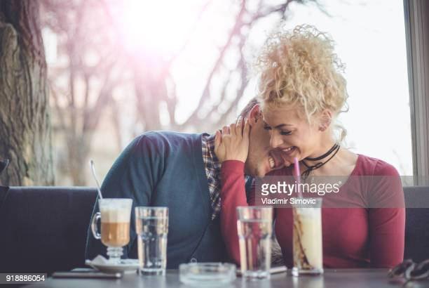 couple in coffee shop - couple tongue kissing stock photos and pictures