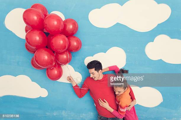 Couple in comic book: flying with balloons
