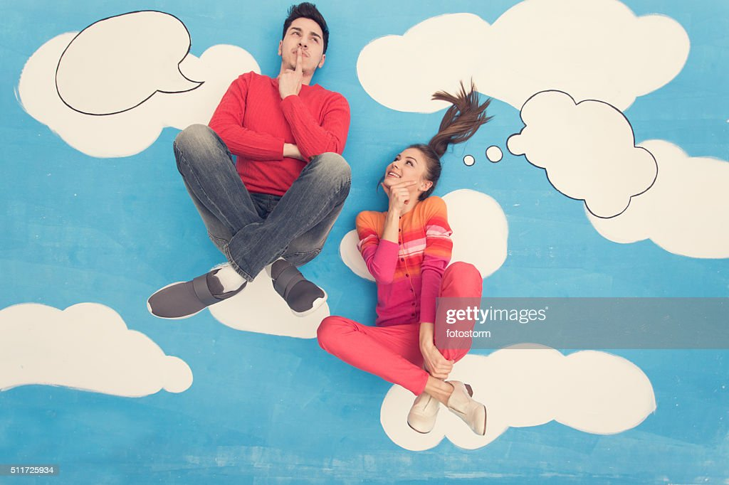 Couple in comic book: Sitting on clouds, thinking : Stock Photo