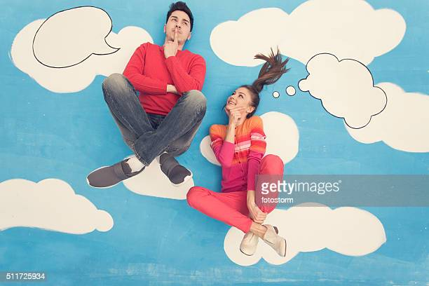 couple in comic book: sitting on clouds, thinking - animation stock pictures, royalty-free photos & images