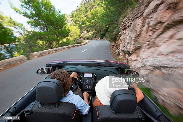 Couple in convertible on road to Cap de Formentor