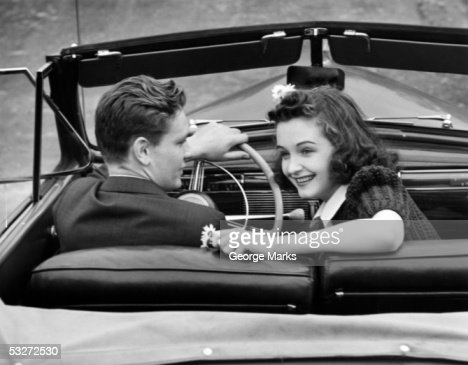 Fifties Couple Driving Classic 1957 Car Stock Photo
