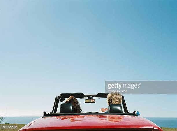 couple in convertible - convertible stock pictures, royalty-free photos & images