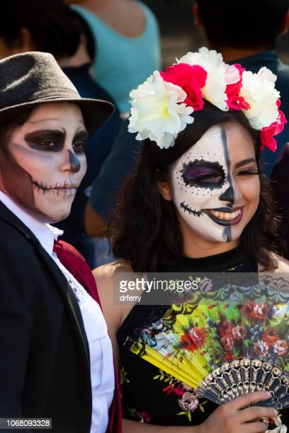 couple in costume at the día de los muertos festival in oaxaca - day of the dead festival stock photos and pictures