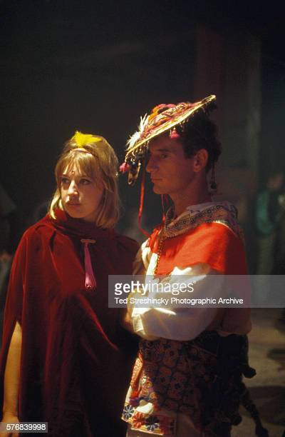 A couple in costume stands together at the Acid Test Graduation a celebration organized by Ken Kesey and his Merry Pranksters in which participants...