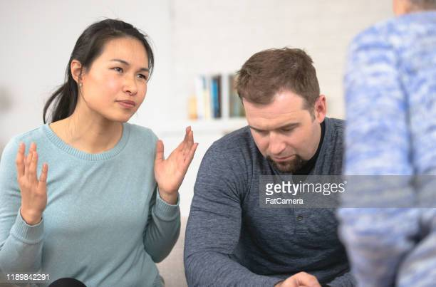 a couple in counseling together stock photo - 30 39 years stock pictures, royalty-free photos & images