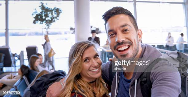 Couple in departure lounge