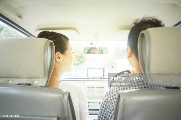 a couple in drive. - land vehicle stock pictures, royalty-free photos & images