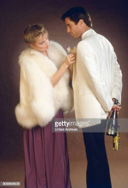 Couple in evening dress 1980s