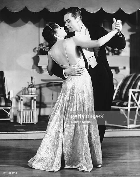 Couple in evening wear dancing (B&W)