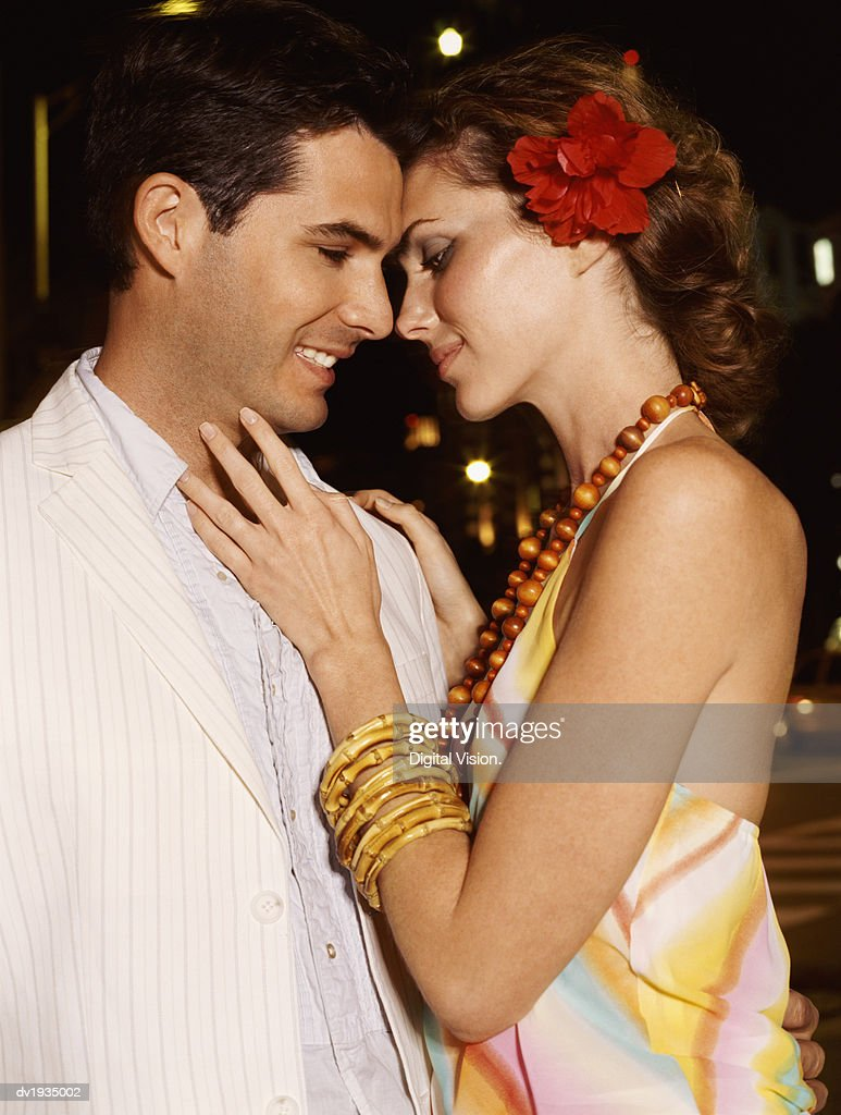 Couple in Evening Wear Embracing Each Other : Stock Photo