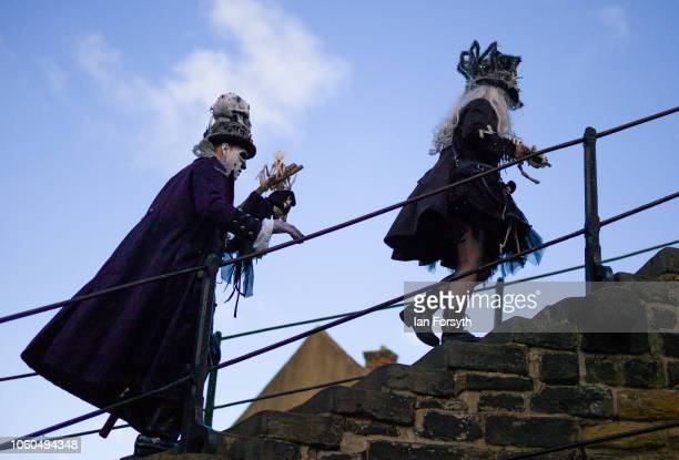 A couple in extravagant goth clothing climb the steps to the Abbey during Whitby Goth Weekend on October 28 2018 in Whitby England Whitby Goth...