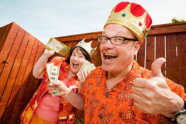 Couple in festive outfits and crowns