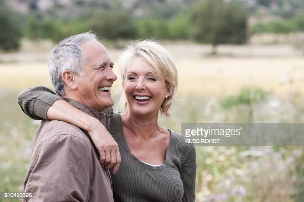 Couple in field smiling