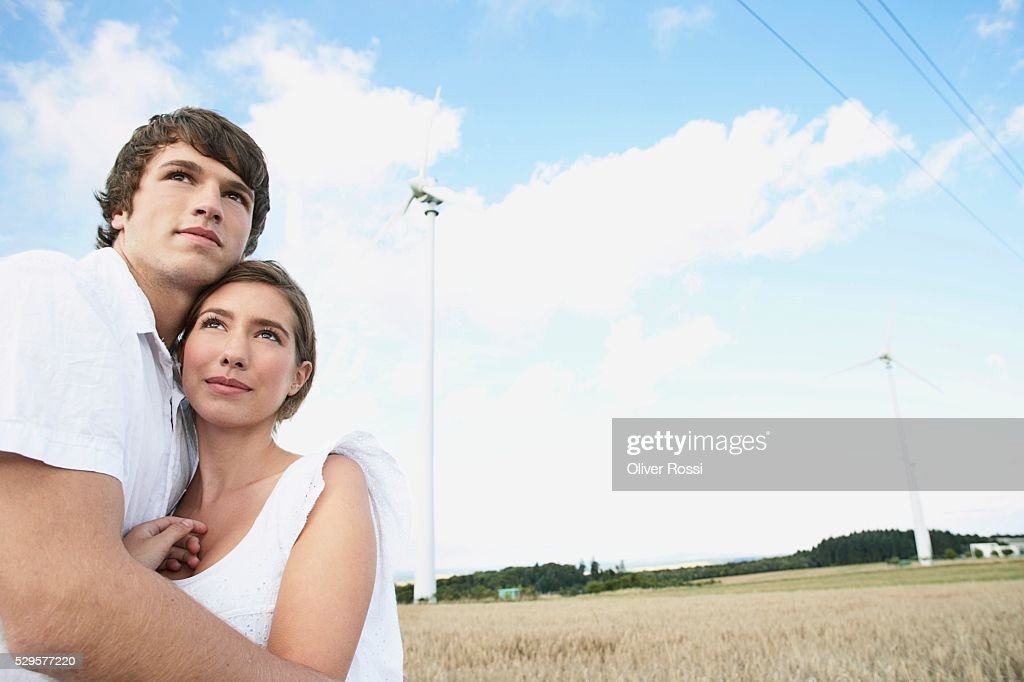 Couple in Field with Windmills : Foto stock