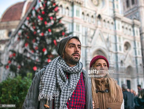 couple in Florence for christmas with christmas tree
