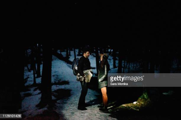 couple in forest at night, tobermory, canada - moonlight lovers stock-fotos und bilder