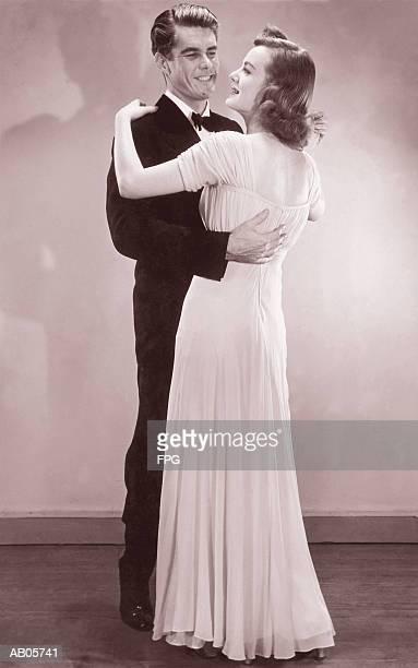 Couple in formal wear dancing (B&W sepia tone)