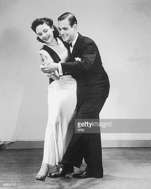 Couple in formal wear dancing (B&W)
