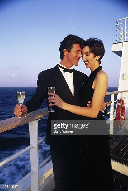 couple in formal wear on ship