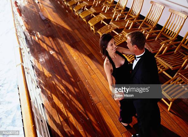 couple in formalwear dancing on a cruise ship deck - evening wear stock pictures, royalty-free photos & images