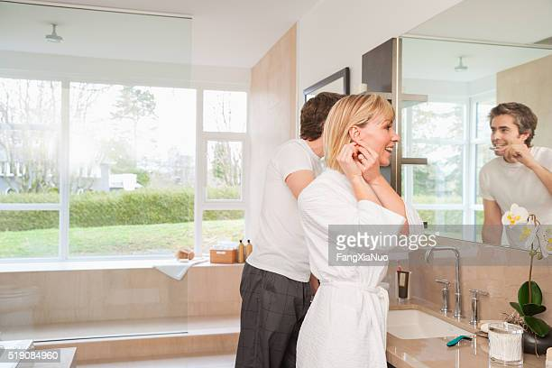 Couple in front of bathroom mirror