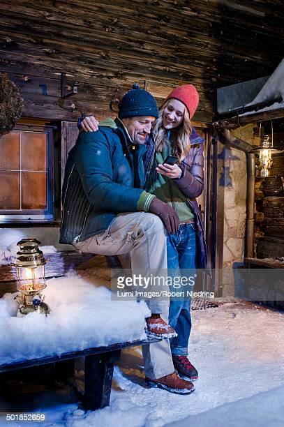 Couple In Front Of Log Cabin, Tyrol, Austria, Europe