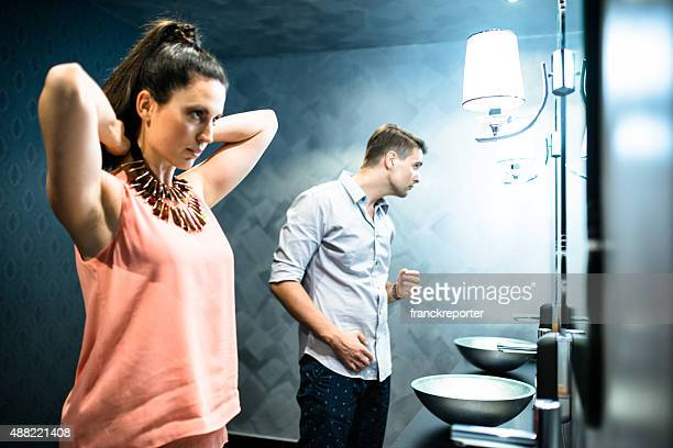 couple in front of mirror before the night out - vanity stock pictures, royalty-free photos & images