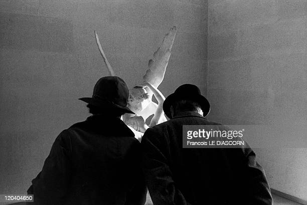 Couple in front of the Statue of Liberty of Canova The Louvre in Paris France in 1977 Love and Psyche sculpture by Canova